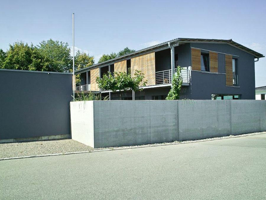 Mehrfamilienhaus von Kaufmann: Modernes Haus in Nachbarschaft