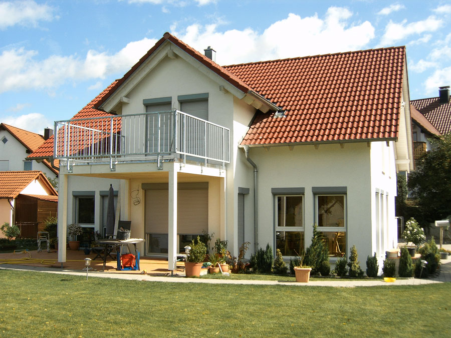 Kaufmann Haus: Dübelholzhaus mit Putzfassade